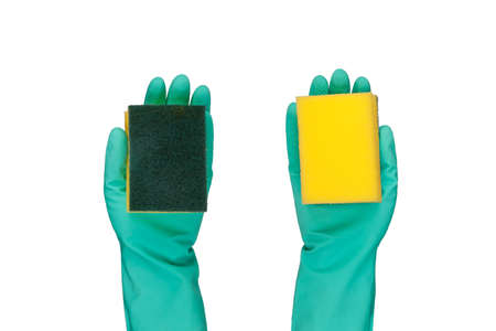 disinfect: Hand with rubber glove holding yellow sponge, isolated on white background. Stock Photo