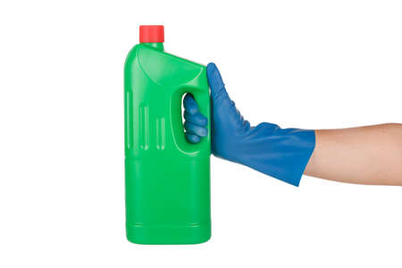 Hand with rubber glove holding green bottle detergent, isolated on white background.