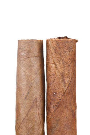 uneatable: Chocolate cigars, isolated on white background.