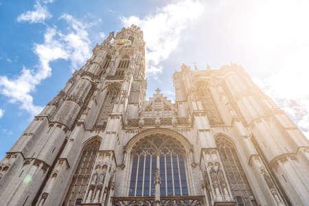 ANTWERP, BELGIUM - JULY 5, 2016 : Belfry tower in Antwerp on cloudy sky. Antwerp is the capital city in the region of Flanders, Belgium