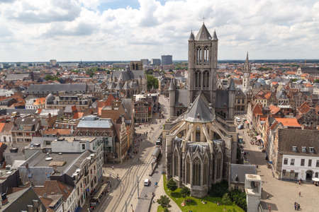 GENT, BELGIUM - JULY 6, 2016 : St Nicholas Church and panoramical aerial landscape view of Gent fromt tower in Belgium. Editorial