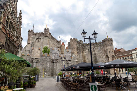 GENT, BELGIUM - JULY 6, 2016 : Exterior view of medieval castle named Gravensteen (Castle of the Counts) in Ghent, Belgium on cloudy sky. Editorial