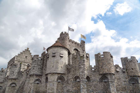 Medieval castle named Gravensteen (Castle of the Counts) in Ghent, Belgium on cloudy sky.