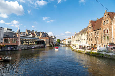 GENT, BELGIUM - JULY 6, 2016 : View of Graslei and Korenlei between medieval architecture buildings with tourist boats in Gent canal. Gent is popular place in Belgium. Editorial