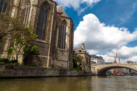 GENT, BELGIUM - JULY 6, 2016 : View of St. Michaels Church and St. Michaels Bridge on Leie River in Gent, Belgium.