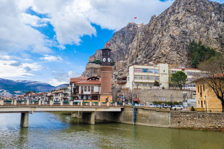 AMASYA, TURKEY - DECEMBER 03, 2016 : Old Ottoman houses and historical clock tower by the Yesilirmak River. Amasya has been a popular hometown for sultans sons for all Ottoman Empire period.