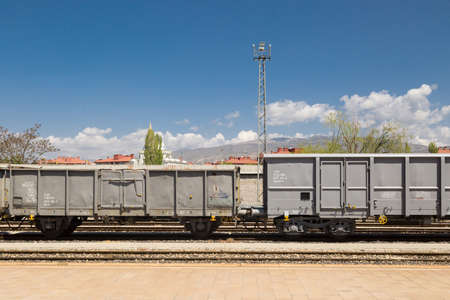 Close up front view of coach of wagon train on cloudy sky background. It is waiting at railway station. Stock Photo