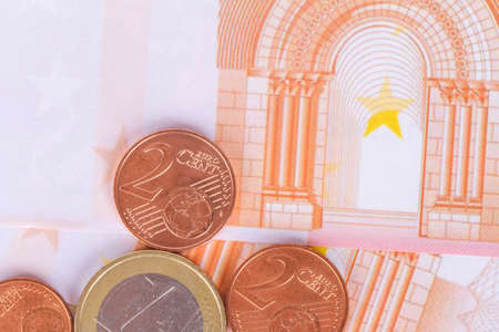 Stack of euro banknotes and coins, currency money in finance concept. Imagens