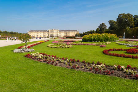 VIENNA, AUSTRIA - SEPTEMBER 11, 2016 : View of Schönbrunn Palace, one of best touristic attractions in Vienna on bright sky background. It is baroque style former summer palace. Stock Photo