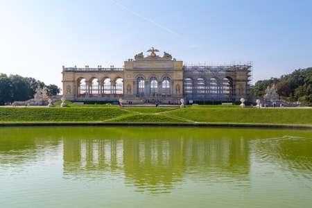 VIENNA, AUSTRIA - SEPTEMBER 11, 2016 : View of Classical Gloriette Arch in Schönbrunn Palace Garden in Vienna, on bright sky background. It was built in 1775. Stock Photo