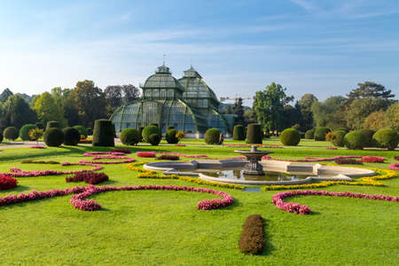 VIENNA, AUSTRIA - SEPTEMBER 11, 2016 : View of Palm House in Sch�nbrunn Palace Garden in Vienna, on bright sky background. It was built in 1883 and has many exotic plant and butterfly species.