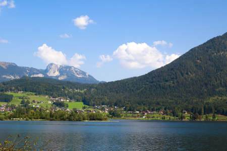 SALZBURG, AUSTRIA - Landscape view of St Gilgen village in Salzburg Austria. St Gilgen is by Lake Wolfgang and Alp Mountains with scenic view on blue sky background. Stock Photo