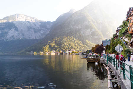 HALLSTATT, AUSTRIA - SEPTEMBER 14, 2016 : Landscape view of Hallstatt village with fancy mountain houses by Hallstatt lake among high Alp Mountains. Editorial