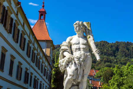 Eggenberg Palace and sculpture of garden in Graz, Styria region of Austria. Editorial