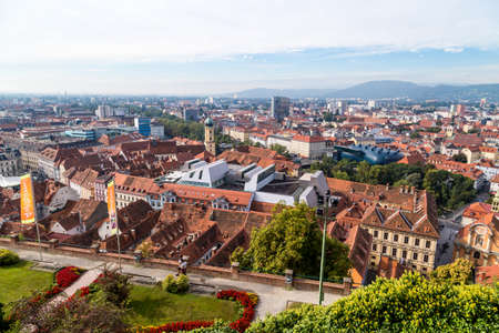 GRAZ, AUSTRIA - SEPTEMBER 16, 2016 : Panoramic view of Graz old town cityscape aerial view from Schlossberg Hill. Styria region of Austria. Stock Photo