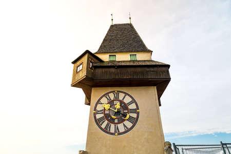 GRAZ, AUSTRIA - SEPTEMBER 16, 2016 : Medieval clock tower Uhrtrum in Schlossberg Castle public park around hill, symbol of Styria region of Austria.