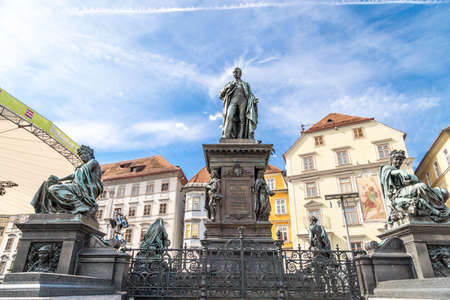 GRAZ, AUSTRIA - SEPTEMBER 16, 2016 : Exterior view of Hauptplatz with sculptures. Main square of Graz historical city in Styria on cloudy sky.
