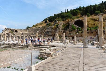 EPHESUS, TURKEY - JUNE 20, 2018 : Ruins in historical ancient city Ephesus with people around on cloudy sky in Izmir, Turkey.