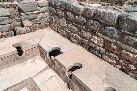 Public toilets in historical ancient city Ephesus, Izmir, Turkey. Stock Photo