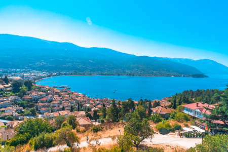 Panoramic view of Ohrid in Republic of Macedonia with mountains by lake.
