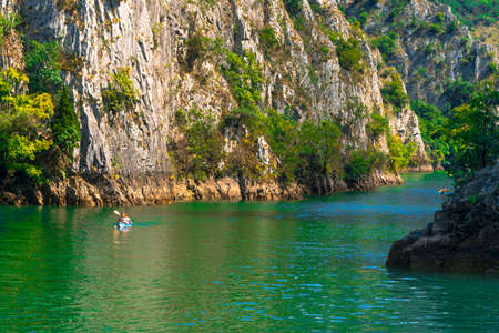 SKOPJE, MACEDONIA - AUGUST 8, 2019 : View of Matka Canyon. Mat is most beautiful touristic attraction near Skopje, people kayaking on landscape. Editorial