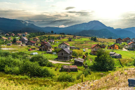 Mountain houses in plateau belong mountains. Reklamní fotografie - 135485165