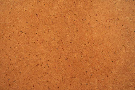 The texture of the wood fiber panels covered with lacquer. Close-up. photo