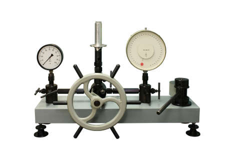 Laboratory piston press of high accuracy. Close-up. Isolated on a white background.