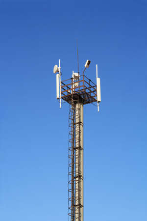 Mast with antennas of cellular communication. Close-up on a background of blue sky. Stock Photo - 5754408