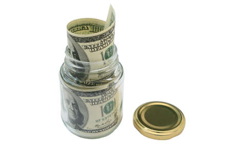 Money in a glass jar. Close-up. Isolated on a white background. photo