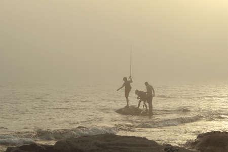 The boys were out fishing. Caspian Sea. photo