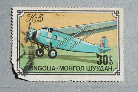 Old Mongolian stamp with the image plane. Stock Photo