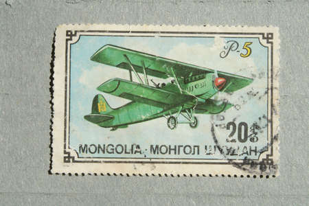 Old Mongolian stamp with the image plane. Stock Photo - 7510420