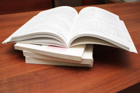 A stack of catalogs on the table. Close-up. Stock Photo