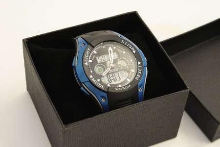 Mens wristwatch in a black box. Close-up.