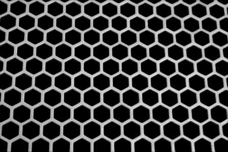 Aluminum honeycomb lattice in the form. Close-up. On a black background. photo