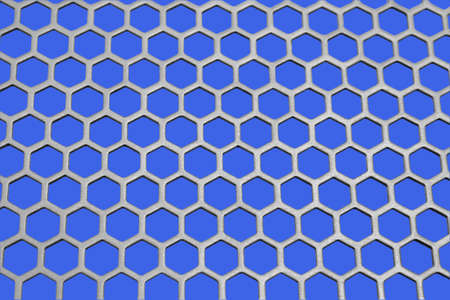 Aluminum honeycomb lattice in the form. Close-up. On a blue background photo