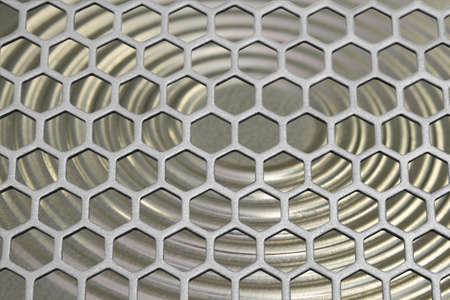 The aluminum grating on the background of a steel membrane. photo