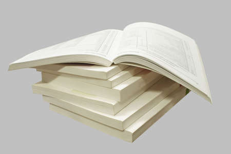 A stack of catalogs, isolated on a gray background.