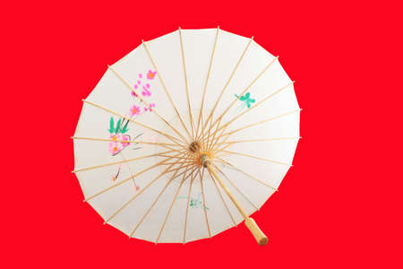 Chinese umbrella isolated on red background. photo