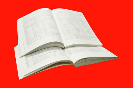 A stack of catalogs, isolated on a red background.