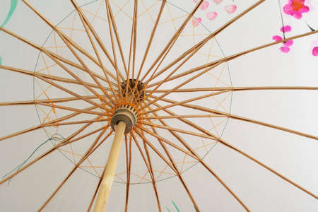 Chinese parasol made of wood. Close-up. photo