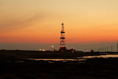 oil field: Drilling sunset. Stock Photo