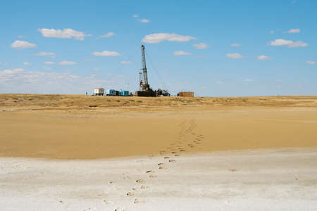 Drilling in the desert. Stock Photo