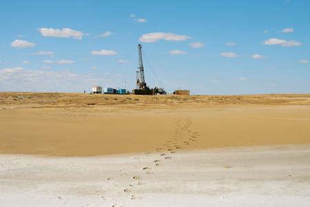 barren land: Drilling in the desert. Stock Photo