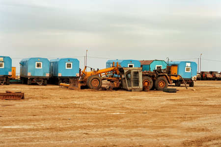 Temporary site office and machinery Editorial