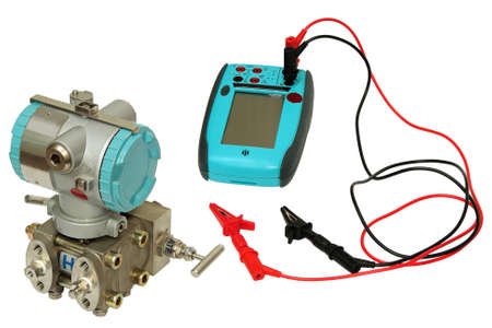 Differential sensor and the calibrator is isolated on a white background. Stock Photo