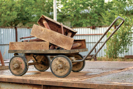 Old cart loaded with scrap metal, close-up.