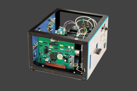 Laboratory equipment, dismantled electronics, isolated on black background  photo