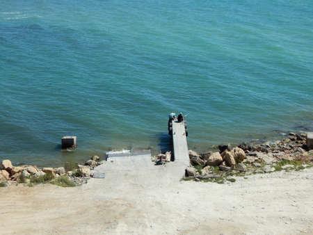 caspian: Fishermen catch fish with a small pier. Caspian Sea.